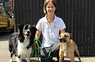 Kay McDonald with two trained dogs